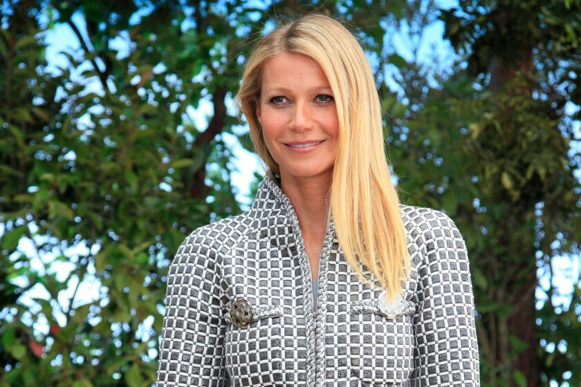 FILE - In this Jan. 26, 2016, file photo, actress Gwyneth Paltrow poses for photographers before Chanel's Spring-Summer 2016 Haute Couture fashion collection in Paris. Opening statements have begun in the trial of a man charged with stalking Paltrow. A prosecutor says Dante Soiu has hunted Paltrow