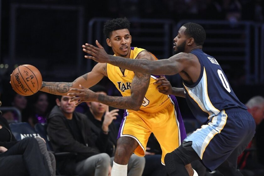 Lakers guard Nick Young, left, tries to pass while under pressure from Memphis Grizzlies forward JaMychal Green during a Jan. 3 game.