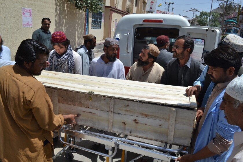 A coffin carries one of the victims of a U.S. drone strike in Pakistan. Afghan Taliban leader Mullah Akhtar Mohammad Mansour was killed in the strike.