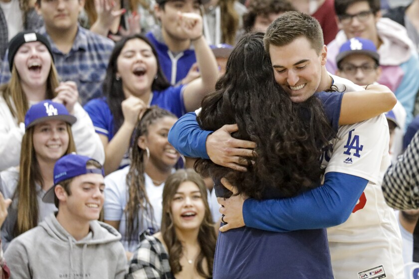 Dodgers pitcher Ross Stripling hugs student during a pep rally at Saugus High School in Santa Clarita on Friday.