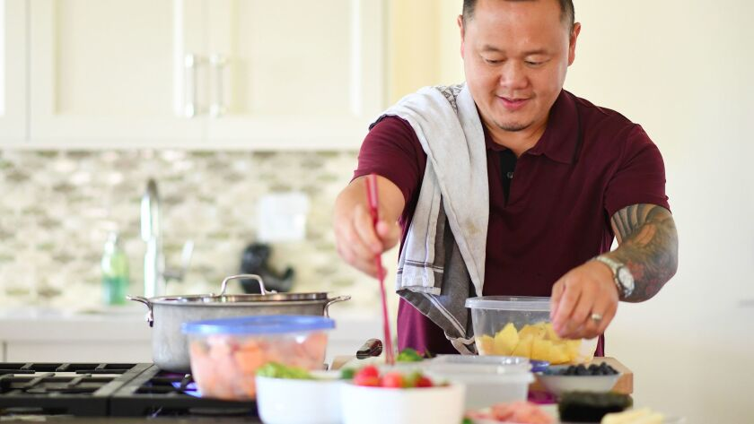 LOS ANGELES-CA-AUGUST 8, 2017: Chef Jet Tila packs his kids' lunch box with Thai BBQ chicken, sticky