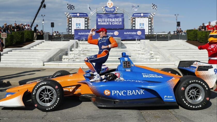 Scott Dixon, of New Zealand, celebrates after winning the second race of the IndyCar Detroit Grand P