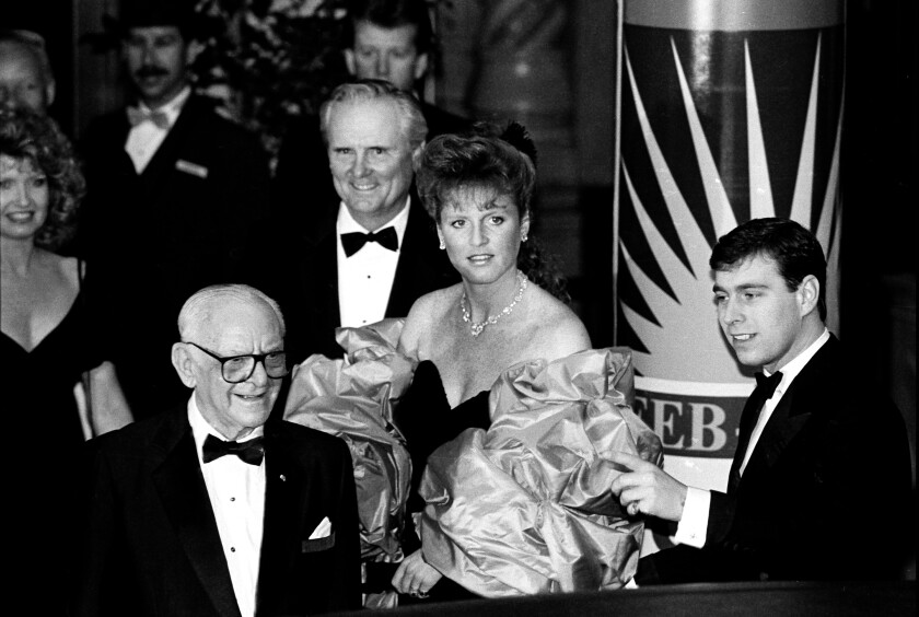 Lodwrick Cook, back center, with Sarah Ferguson and her husband, Prince Andrew, at a 1988 gala.