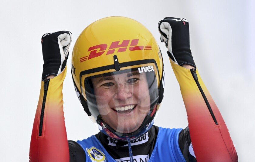 Natalie Geisenberger from Germany is happy about her victory at the luge World Cup in Oberhof, Germany, Sunday, Jan. 17, 2021.(Hendrik Schmidt/dpa via AP)