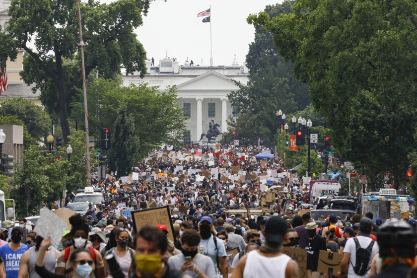 Demonstrators gather near the White House in Washington