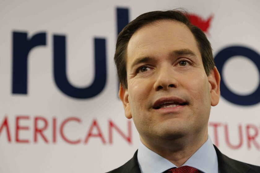Republican presidential candidate, Sen. Marco Rubio, R-Fla., speaks to the media before he speaks to a crowd at Mount Paran Christian School, Saturday, Feb. 27, 2016, in Kennesaw, Ga. (AP Photo/Mike Stewart)