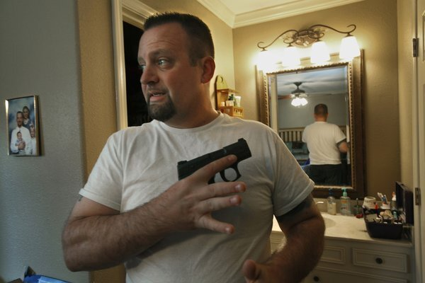 The Rev. James McAbee, pastor at Lighthouse Worship Center in Beaumont, Texas, teaches concealed handgun classes.
