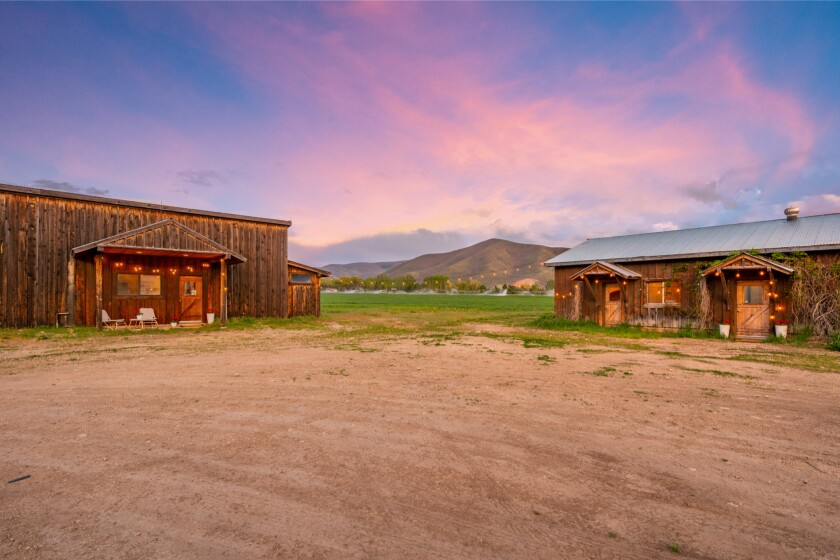 The 30-acre ranch is tucked into a scenic spread of mountains, valleys and rivers.