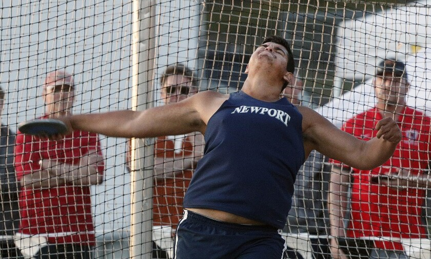 Newport Harbor's Aidan Elbettar throws the discus at the Arcadia Invitational at Arcadia High School