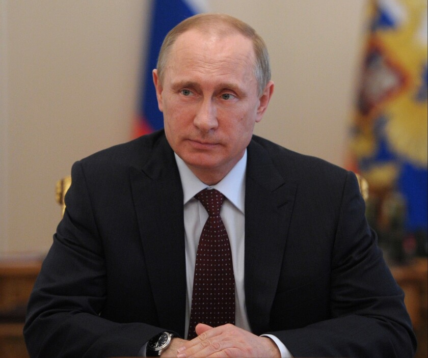 Russian President Vladimir Putin chairs a Security Council meeting in the Novo-Ogaryovo residence outside Moscow.