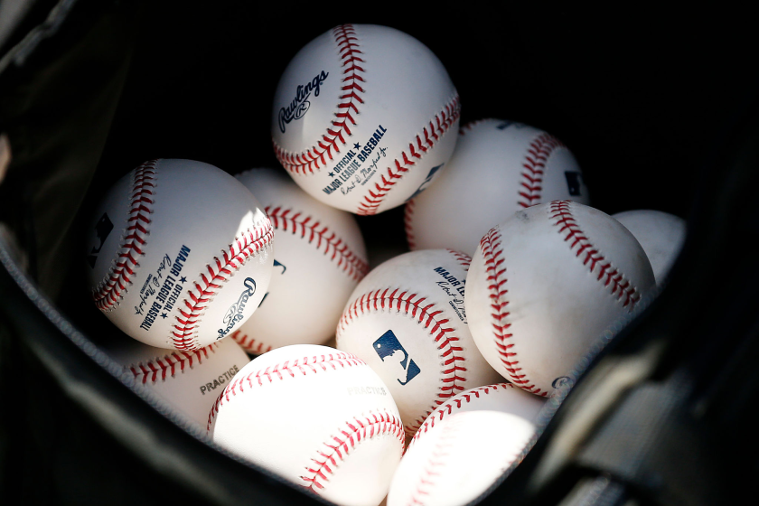 Baseballs are stored in a bucket.