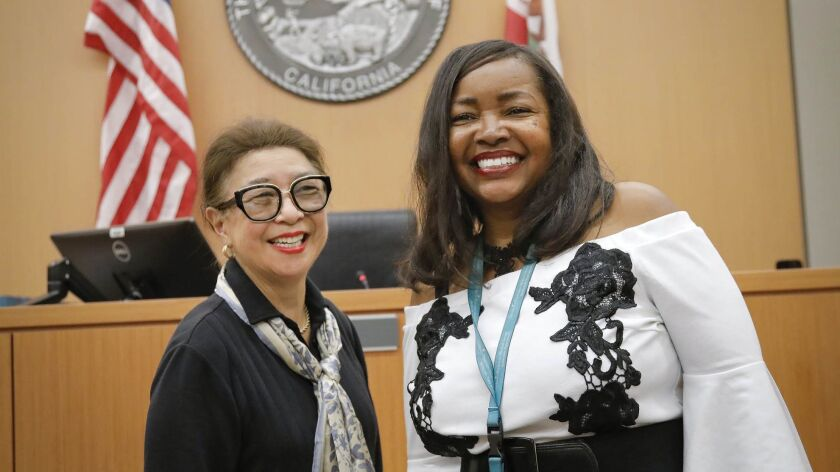 San Diego Superior Court Judge Gale Kaneshiro, left, presided over a retirement buffet luncheon for courtroom clerk Frieda McCurley, right,