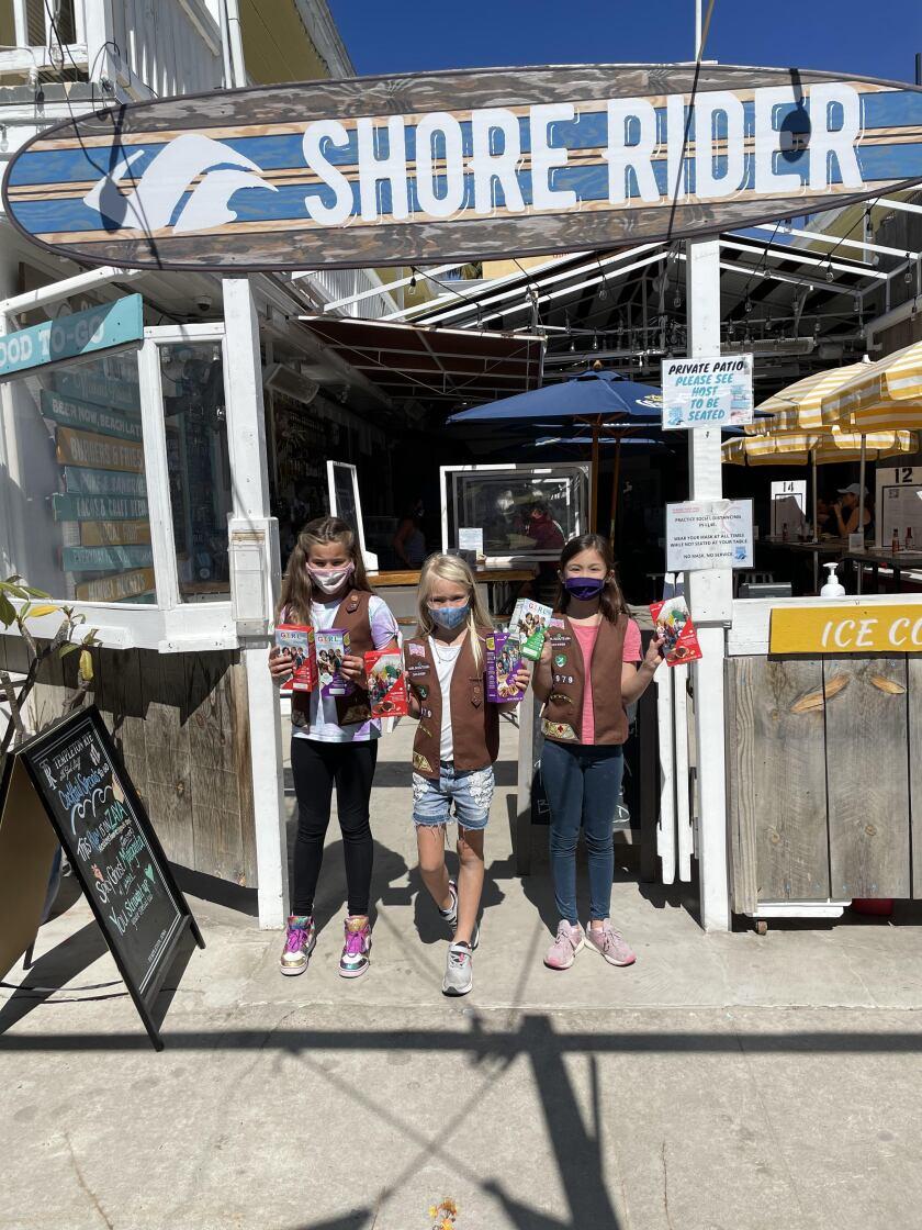 Girl Scout Brownie troop members at their pop-up cookie shop at Shore Rider in La Jolla.