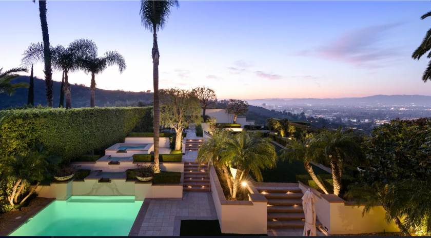 Found in guard-gated Mulholland Estates, the home holds seven bedrooms and 10 bathrooms in 7,500 square feet.