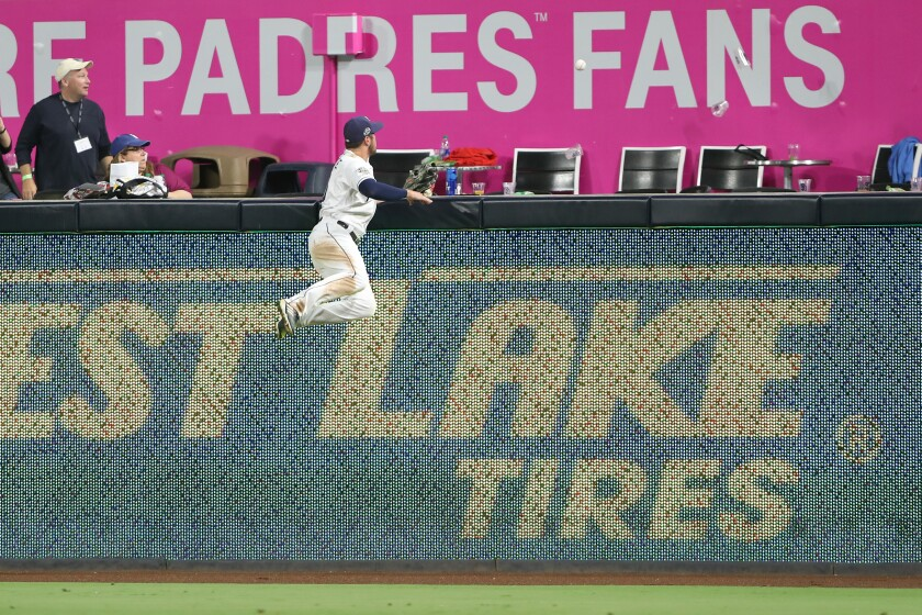 Padres right fielder Hunter Renfroe watches a solo home run hit by the Dodgers' A.J. Pollock sail over the fence during the ninth inning.