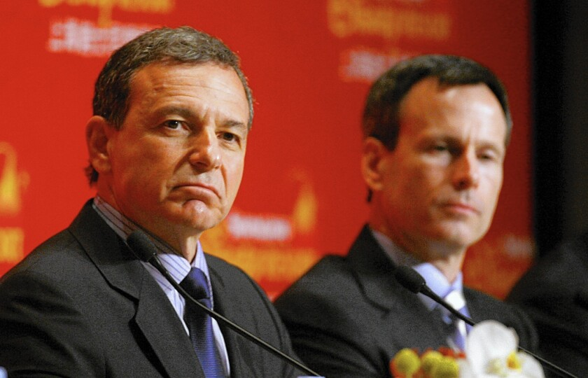 Thomas Staggs, right, who is leaving Disney in May, had been the heir apparent to CEO Robert Iger, whose contract expires in 2018.