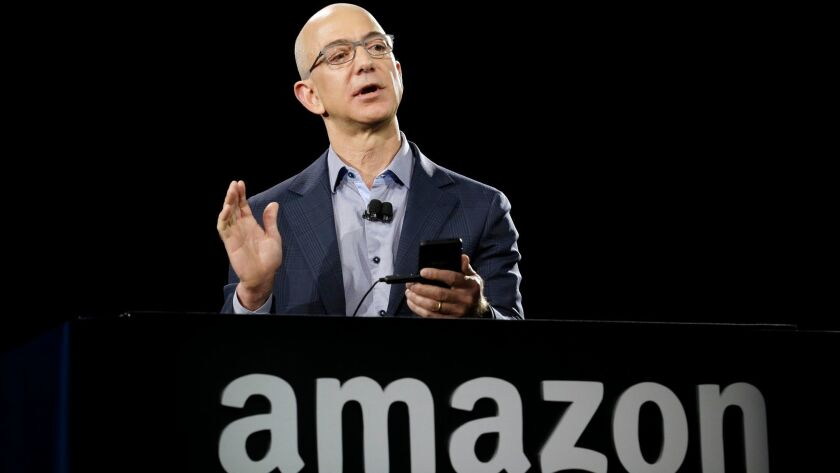 Amazon CEO Jeff Bezos demonstrates a new Amazon phone in Seattle, Wash. on June 18, 2014.