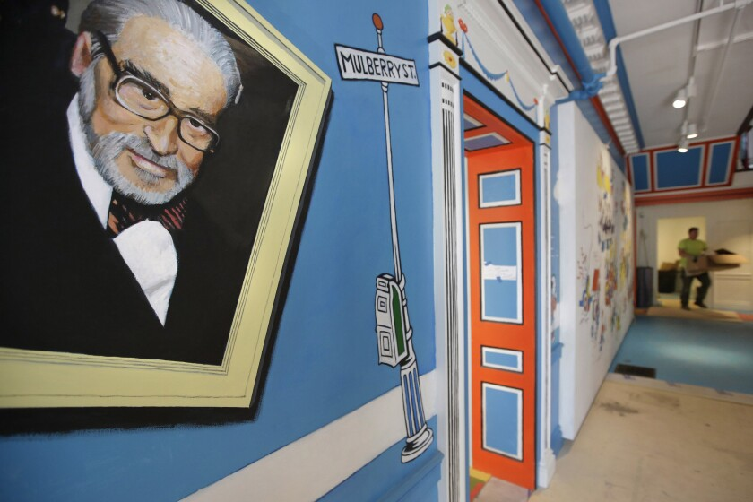 A mural featuring Theodor Geisel, known as Dr. Seuss, is pictured near an entrance at The Amazing World of Dr. Seuss Museum.