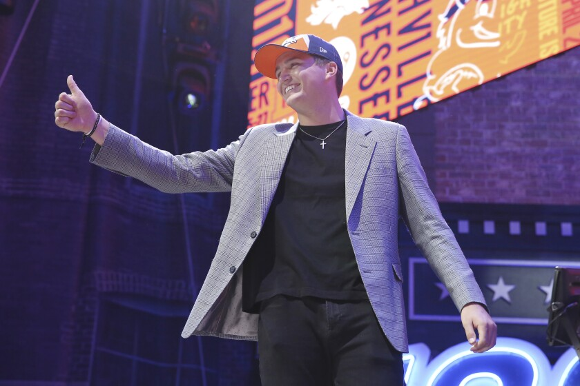 Missouri quarterback Drew Lock gives a thumbs up to the crowd on stage after the Denver Broncos selected him during the second round of the NFL Draft on Friday in Nashville, Tenn.
