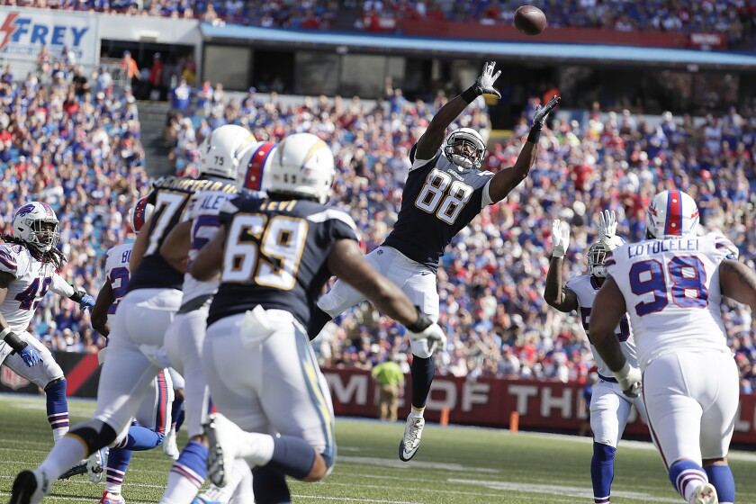 Chargers tight end Virgil Green reaches out for a deflected pass from quarterback Philip Rivers during a second-half drive against the Buffalo Bills at New Era Field on Sunday.