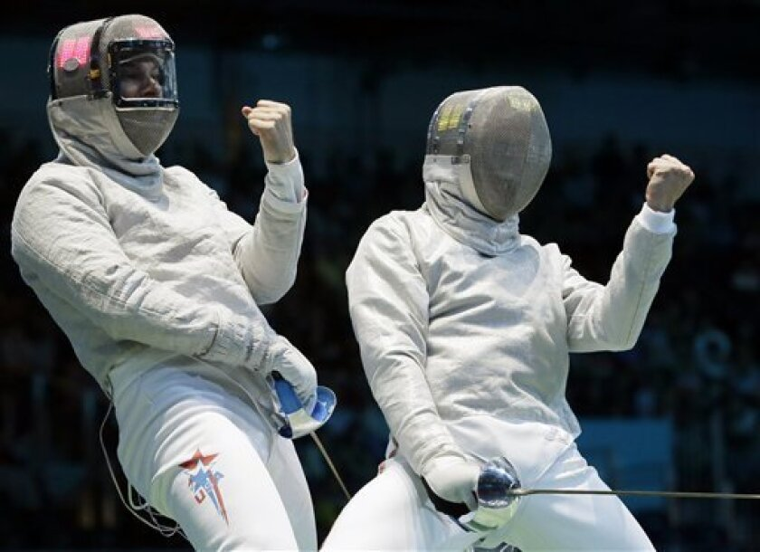 USA's Timothy Morehouse and Belarus' Dmitri Lapkes react during the men's individual sabre round of 16 fencing at the 2012 Summer Olympics, Sunday, July 29, 2012, in London. (AP Photo/Dmitry Lovetsky)