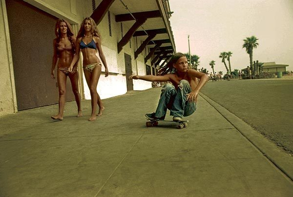 """The cover photograph of """"Locals Only"""" is titled """"Sidewalk Surfer,"""" taken in 1975 in Huntington Beach. Photographer Hugh Holland hung around with skateboarders all over Southern California to capture images that show an era when it was skateboarding for skateboarding's sake."""