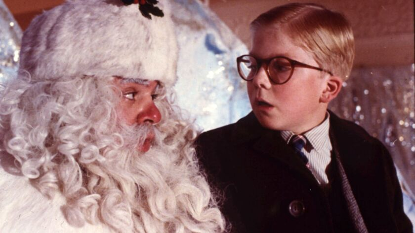 """Ralphie Parker (Peter Billingsley) attempts to express his need to Santa for an """"official Red Ryder, carbine action, 200-shot, range model air rifle"""" in """"A Christmas Story,"""" which will air nonstop over 24 hours from Christmas Eve through Christmas Day on TBS and TNT."""