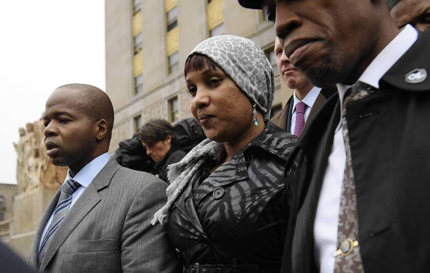 Nafissatou Diallo, the hotel maid who accused Dominique Strauss-Kahn of sexually assaulting her, leaves court in New York after settling her civil suit against him.