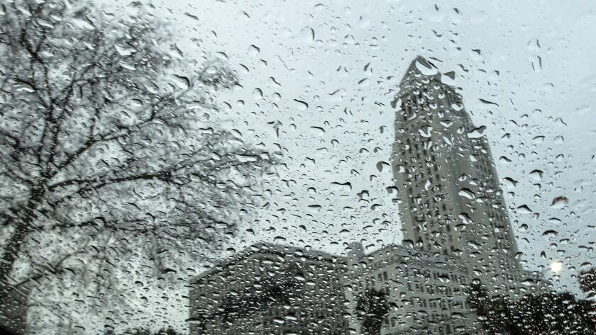 Los Angeles City Hall seen through a rain-covered window.