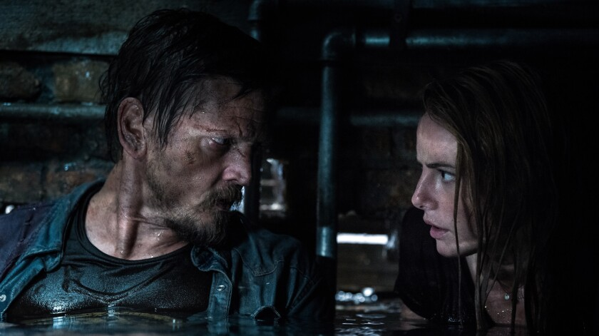 "Barry Pepper and Kaya Scodelario in ""Crawl."""