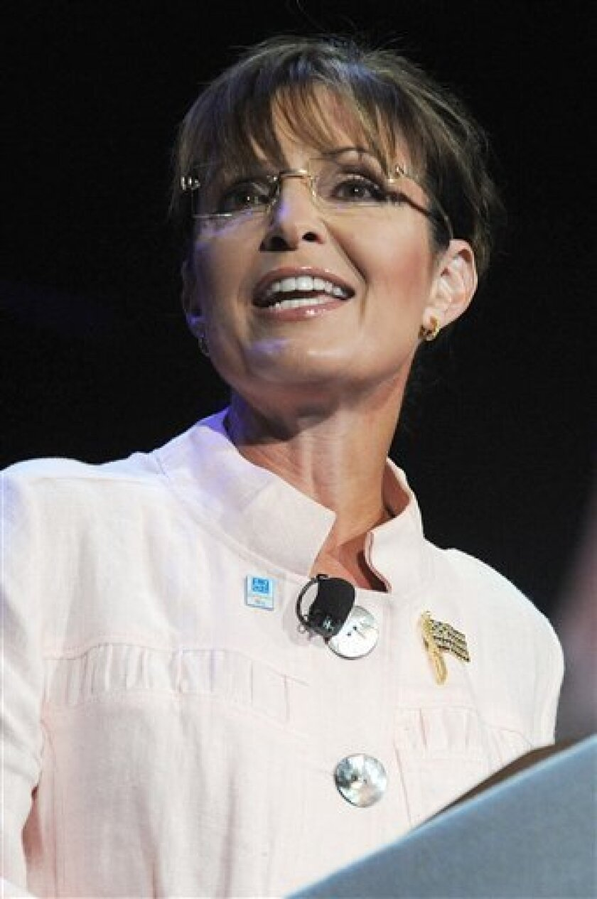 FILE - In this June 29, 2010 file photo, former Alaska Gov. Sarah Palin speaks to the crowd at the P.U.R.E. Ministries in Duluth, Ga. An event featuring Palin and conservative commentator Glenn Beck on Saturday night is likely to bring out two very different crowds. (AP Photo/Erik S. Lesser, File)