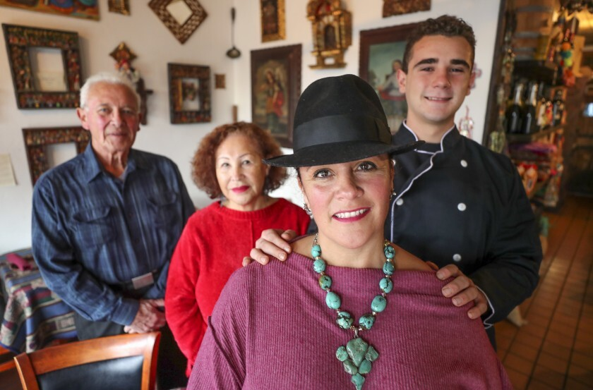 Q'ero restaurant owner Monica Szepesy, foreground, with her son Niko Szepesy Ortega, 18, and her parents Gene and Carmen Szepesy inside the Peruvian restaurant in Encinitas on Wednesday, Nov. 27.