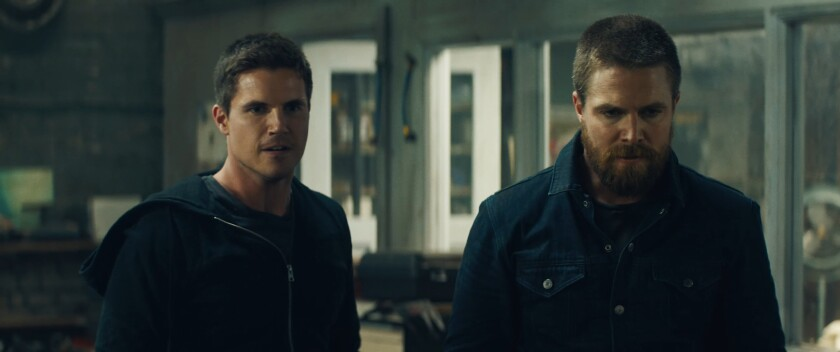 "Robbie Amell and Stephen Amell in a scene from ""Code Eight."""