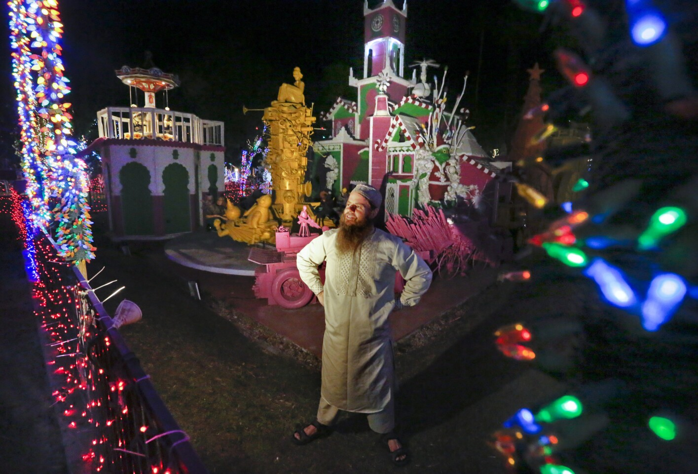 Artist Kenny Irwin Jr. checks the lights in front of the Candy Cane Palace area of his elaborate and quirky Robolights display in Palm Springs.