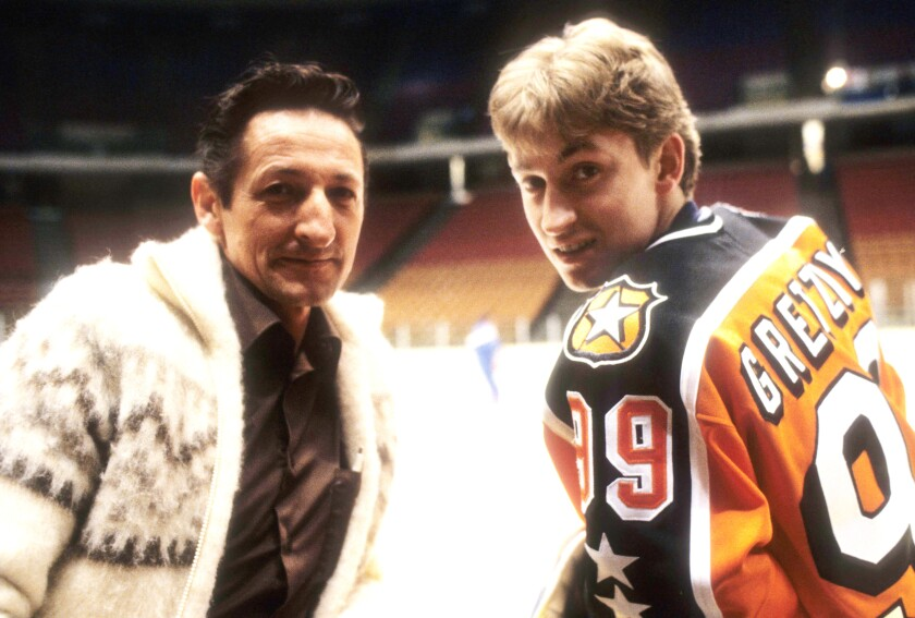 Wayne Gretzky and his father, Walter Gretzky, in 1984