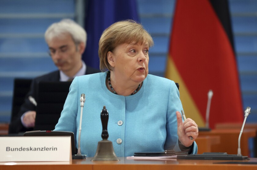 German Chancellor Angela Merkel speaks prior to the start of the weekly cabinet meeting at the Chancellery in Berlin, Germany, Wednesday, June 10, 2020. (Fabrizio Bensch/Pool Photo via AP)