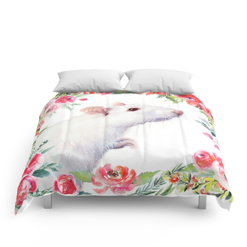 A white rat is the centerpiece of this floral comforter.