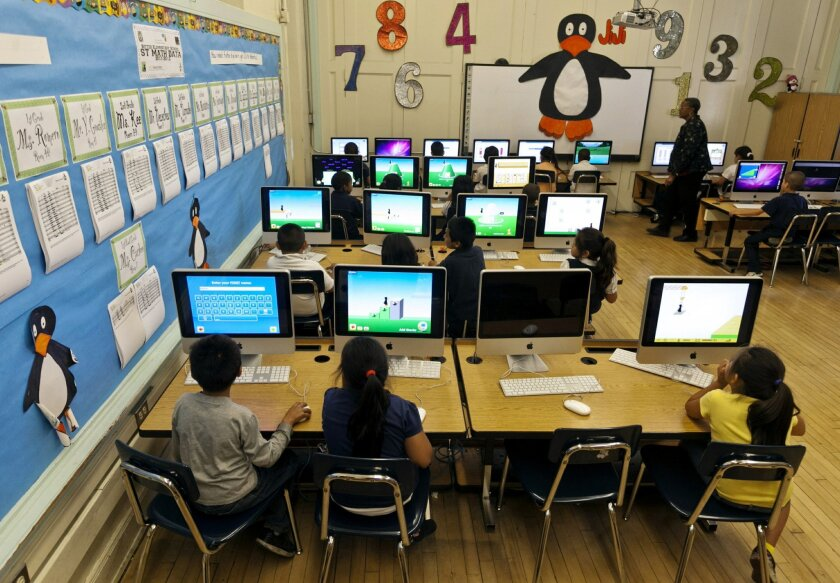 FILE - In this May 15, 2012 file photo, Ritter Elementary School elementary students practice their math skills in Los Angeles.