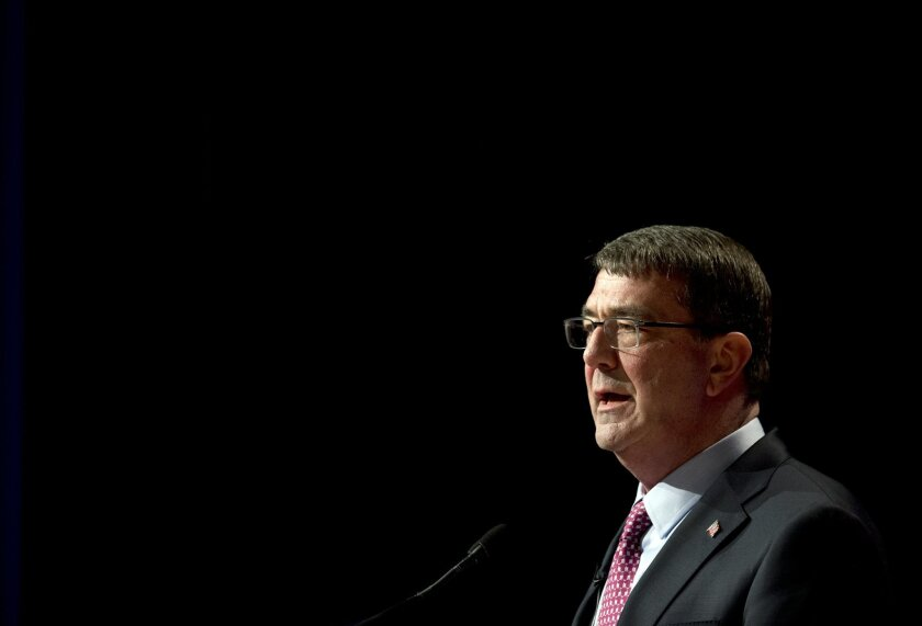 File-This March 6, 2015, file photo shows Defense Secretary Ash Carter, speaking during a ceremonial swearing-in ceremony at the Pentagon.  Carter is considering easing some military enlistment standards as part of a broader set of initiatives to better attract and keep quality service members and