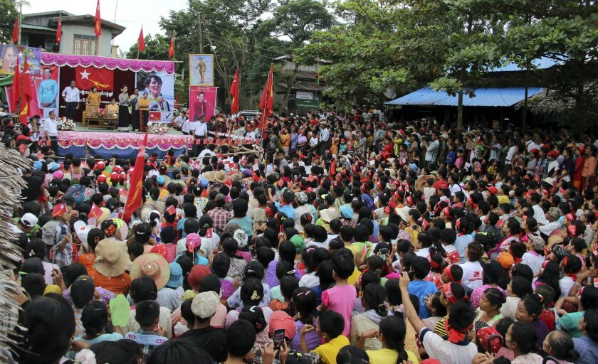 Myanmar opposition leader Aung San Suu Kyi speaks during an election campaign at a village in Kaw-Hmu, her constituency for upcoming general election, Monday, Sept. 21, 2015, on the outskirts of Yangon, Myanmar. Myanmar's general elections are scheduled for Nov. 8, 2015, the first since a nominally civilian government was installed in 2011. (AP Photo/Khin Maung Win)