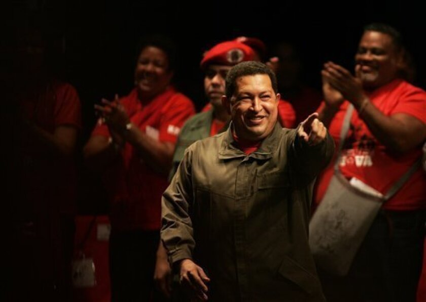 Venezuela's President Hugo Chavez points as he attends a rally with members of the Socialist United Party of Venezuela, PSUV, in Caracas, Wednesday, Jan. 7, 2009. Venezuela ordered Tuesday Israel's ambassador expelled in protest over the military offensive in the Gaza Strip, prompting Israel to con