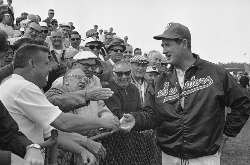 Ted Williams, the new manager of the Washington Senators, greets baseball fans who were on hand in Pompano Beach, Fla., Feb. 25, 1969, when Williams made his first appearance in his new role. The fans gave Williams a big round of applause when he stopped by to say hello.
