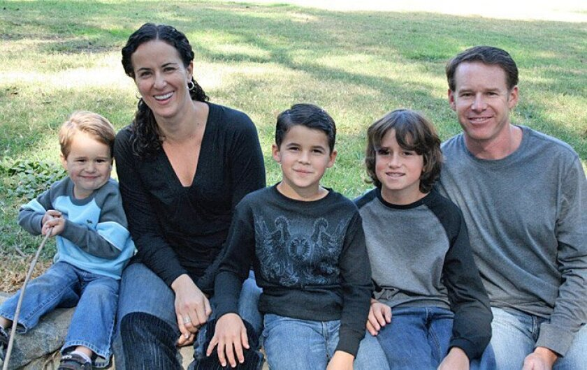 """The DeWeese family (from left) — Dominick, 3; Caroline; Anthony, 8; Nathan, 9; and Alan. The parents, who attended a Coast Guard court-martial of one boat crew member Wednesday, called the petty officer's sentence """"a slap on the wrist"""" for the death of Anthony."""