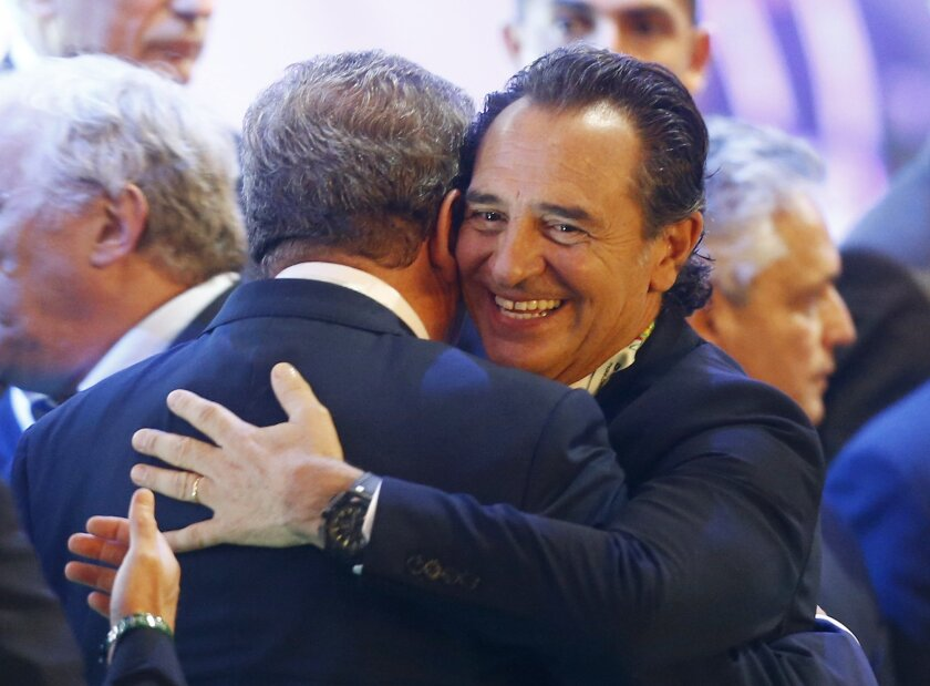 England manager Roy Hodgson hugs Italy head coach Cesare Prandelli, right, after the draw ceremony for the 2014 soccer World Cup in Costa do Sauipe near Salvador, Brazil, Friday, Dec. 6, 2013. (AP Photo/Victor R. Caivano)