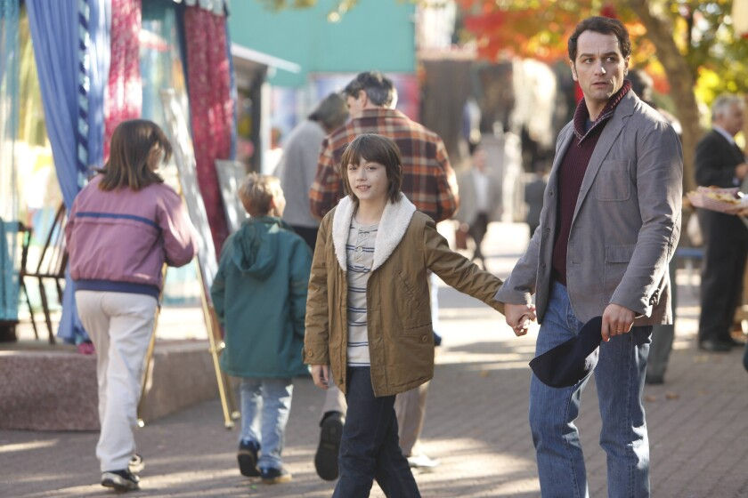 """Things aren't always what they seem in """"The Americans,"""" with Keidrich Sellati, left, as Henry Jennings and Matthew Rhys as Philip Jennings."""