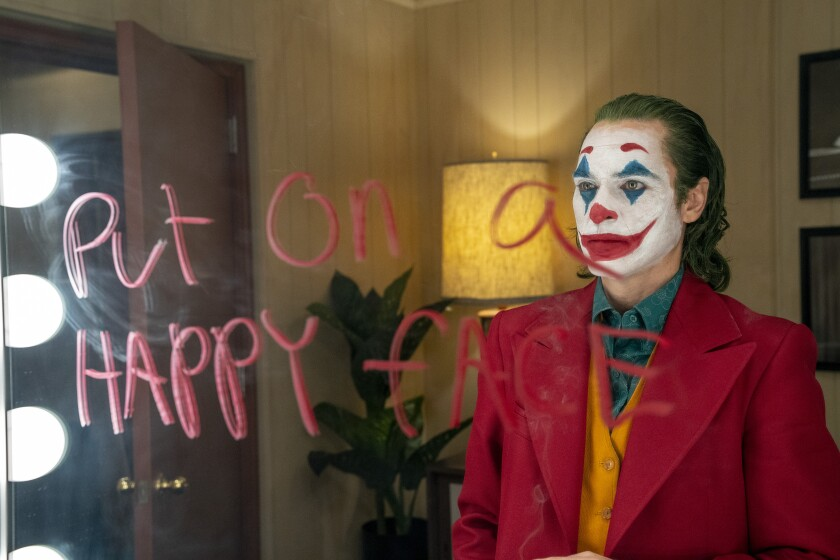 "Joaquin Phoenix in ""Joker,"" a movie he says is about ""childhood trauma, gun violence, isolation and mental health."""