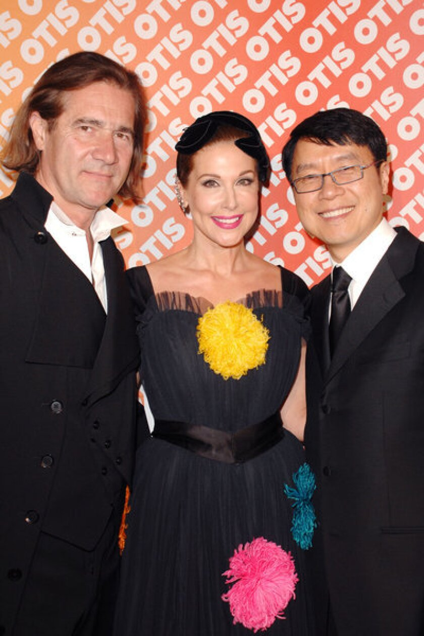 Michel Perrin, from left, Sally Perrin and Sammy Hoi at the 31st annual Otis College of Art and Design scholarship benefit fashion show at the Beverly Hilton Hotel.