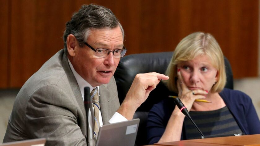 Cal State board of trustees Chairwoman Rebecca Eisen, right, listens to CSU Chancellor Timothy P. White during a July meeting in Long Beach.