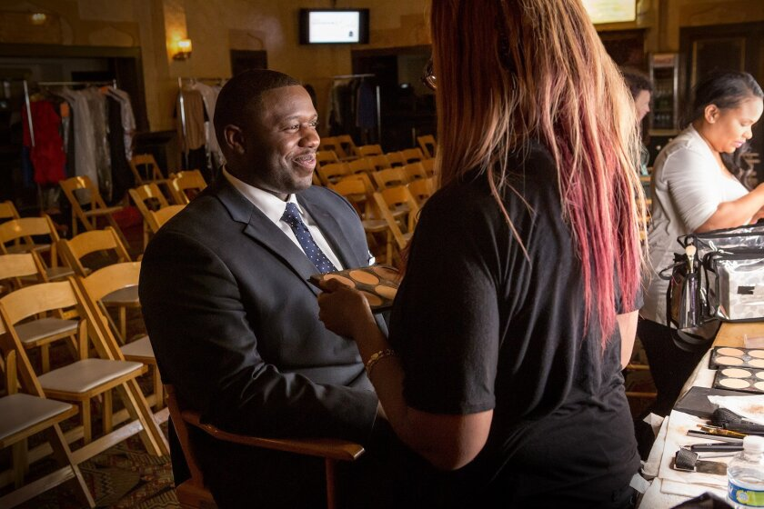 """This May 2014 photo released by Starz shows Associated Press writer Jonathan Landrum having make-up applied before his appearance as an extra on the new sitcom """"Survivor's Remorse."""" Landrum, a newsman based in Atlanta, spent more than five hours on the set for a red carpet scene held at the Fox Theatre. He describes his experience as a first-time extra. (AP Photo/Starz, Quantrell D. Colbert)"""