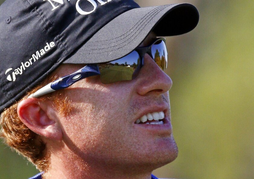 Roberto Castro's sunglasses reflect the No. 10 fairway during the second round of the Sanderson Farms Classic golf tournament, Friday, Nov 6, 2015, in Jackson, Miss. (AP Photo/Rogelio V. Solis)